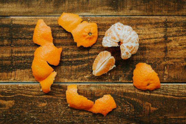 Peeled tangerine on a rustic wooden background
