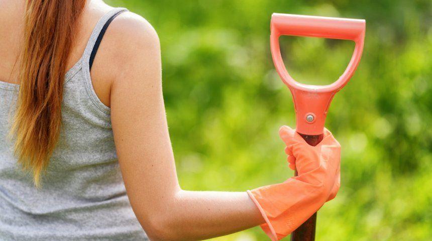 : Woman working in the garden.